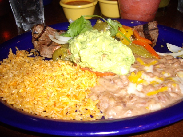 Carne Asada Plate with rice, beans and guacamole